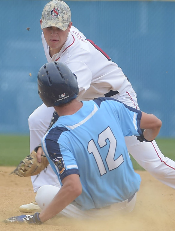 . PETE BANNAN  DIGITAL FIRST MEDIA   Spring City  second baseman (6) JC Reed tags out Lionville (12) Will Peiffer as the Red Sox defeated Lionville 9-5 Tuesday at Immaculata University to wrap up its first Chester County American Legion Baseball championship since 2012.