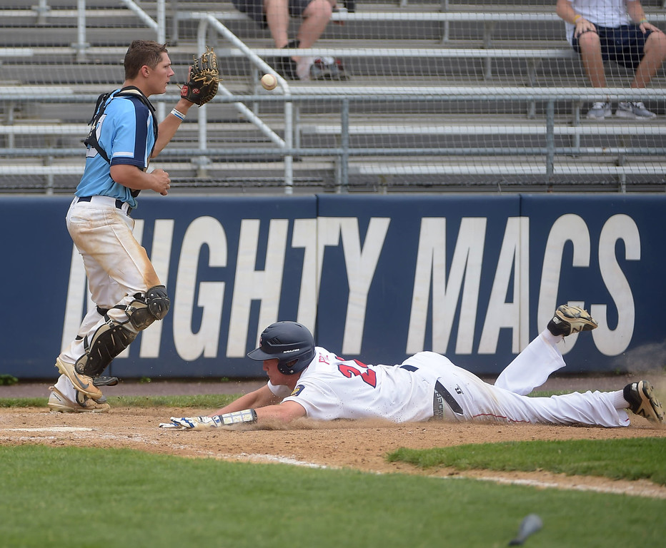 . PETE BANNAN  DIGITAL FIRST MEDIA   Spring City runner (24) N Price scores  the sixth inning of the Red Sox 9-5 victory Tuesday at Immaculata University to wrap up its first Chester County American Legion Baseball championship since 2012.