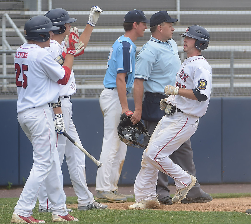 . PETE BANNAN  DIGITAL FIRST MEDIA   Spring City runner (8) Sean McHughes is greated by teammates after he scored in the sixth inning against Lionville  Tuesday at Immaculata University to wrap up its first Chester County American Legion Baseball championship since 2012.
