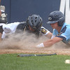 PETE BANNAN  DIGITAL FIRST MEDIA  Lionville hitter (2) Joey Bendixen is taggedout at home by Spring City catcherSam Barletta at Immaculata University Tuesday.