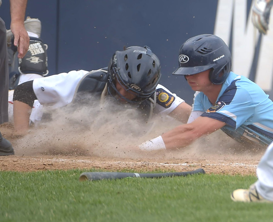 . PETE BANNAN  DIGITAL FIRST MEDIA  Lionville hitter (2) Joey Bendixen is taggedout at home by Spring City catcherSam Barletta at Immaculata University Tuesday.