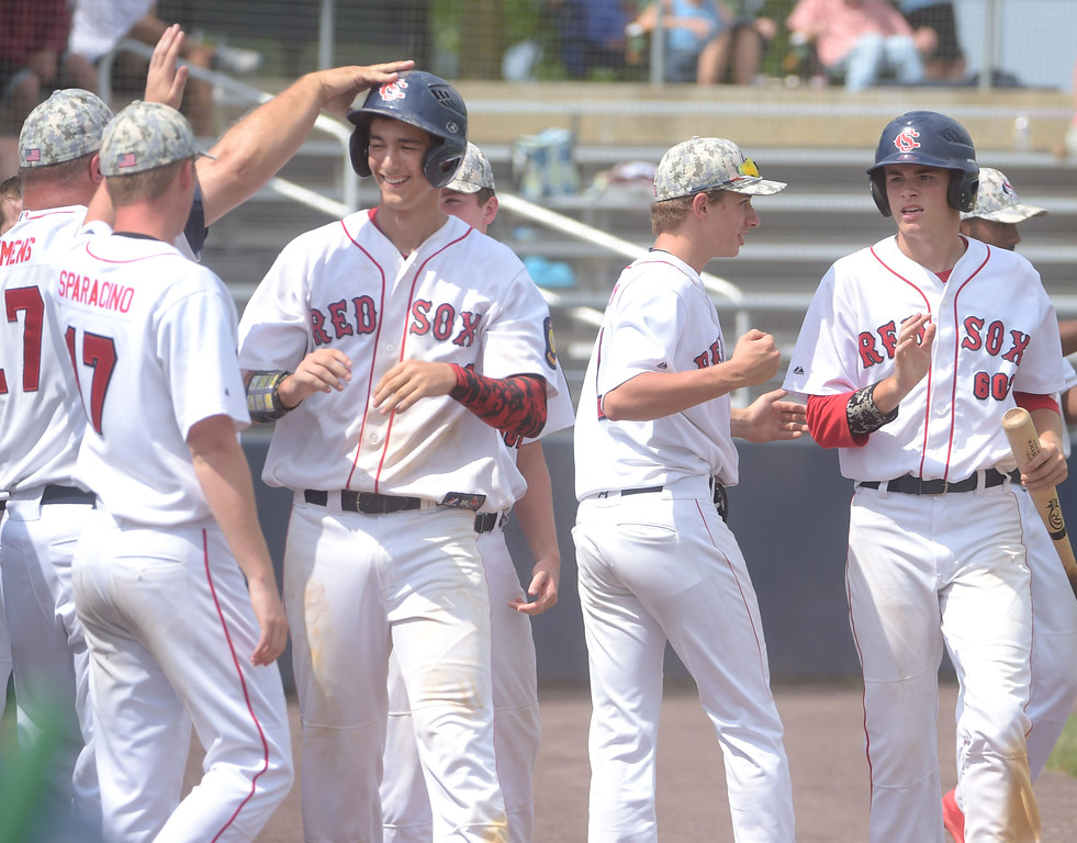 . PETE BANNAN  DIGITAL FIRST MEDIA   Spring City (18) Kasey Caras left and (7)Thomas Hughes, right get congratulations from teammates after scoring the final runs with the Red Sox defeated Lionville 9-5 Tuesday at Immaculata University to wrap up its first Chester County American Legion Baseball championship since 2012.