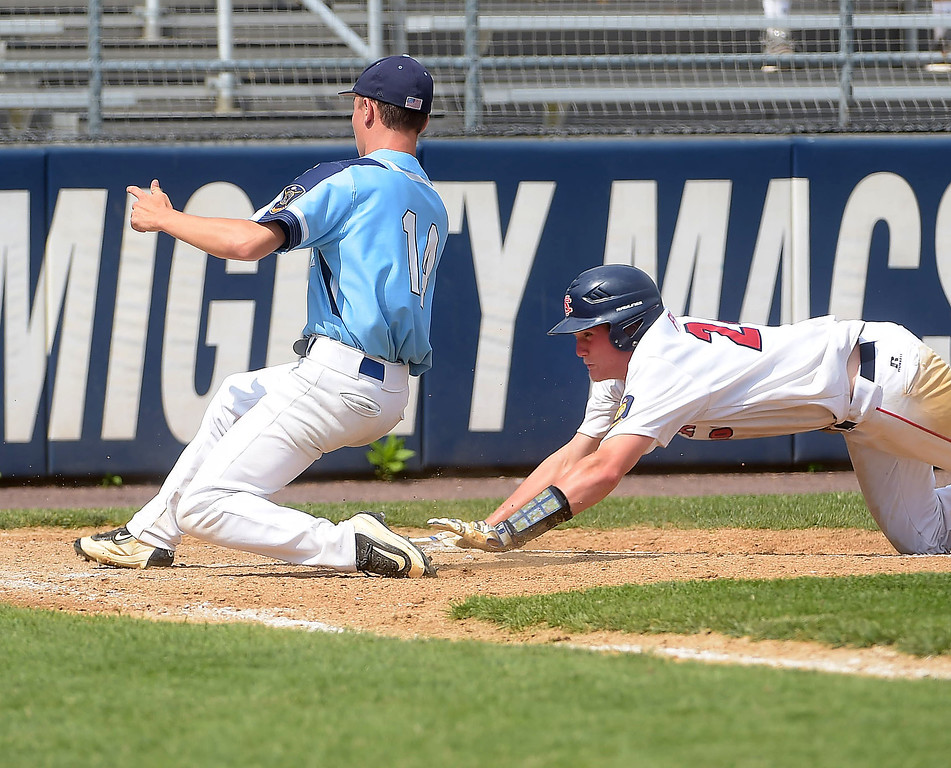 . PETE BANNAN  DIGITAL FIRST MEDIA   Spring City runner (24) Nick Price beats the tag by Lionville pitcher (14) James Murray to score in the Red Sox 9-5 victory Tuesday at Immaculata University to wrap up its first Chester County American Legion Baseball championship since 2012.