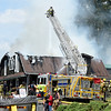 PETE BANNAN-DIGITAL FIRST MEDIA   A structure on the 100 block of Spring Hollow rd. in East Pikeland Township was destroyed in a two alarm fire Tuesday.  One firefighter was treated for heat exhaustion. Four pets were missing.