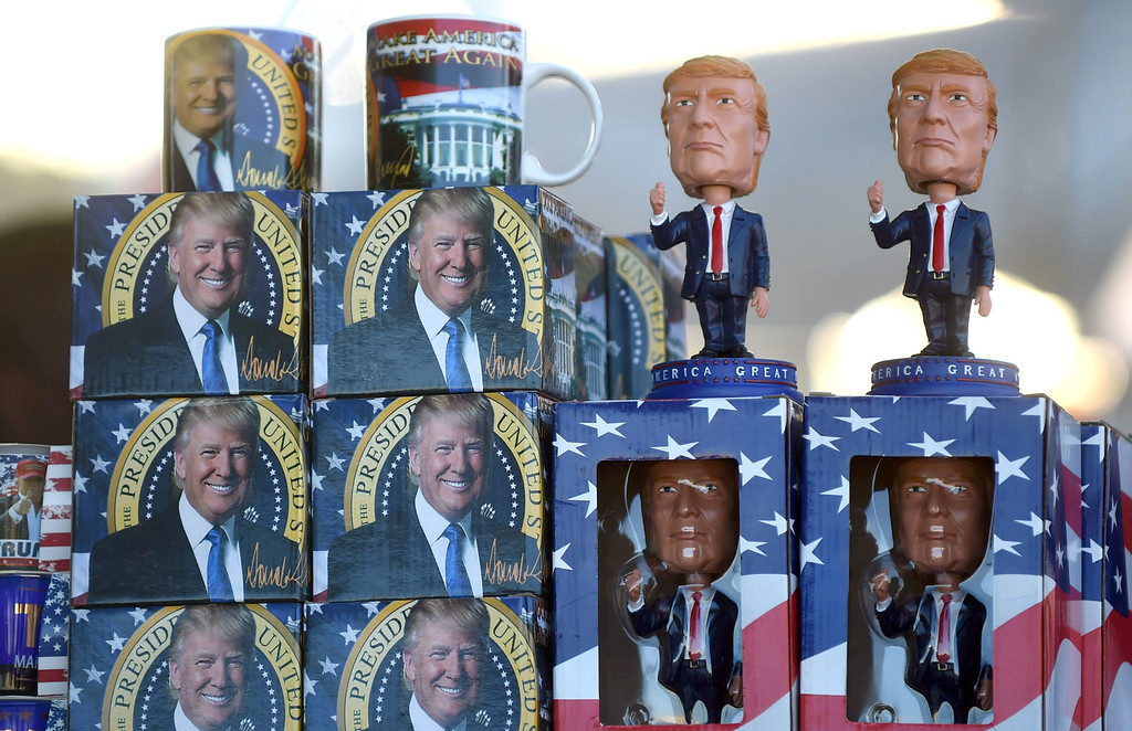 . PETE  BANNAN-DIGITAL FIRST MEDIA    Trump merchandise  for sale out front of the Sun Center before the Trump rally Thurday evening.