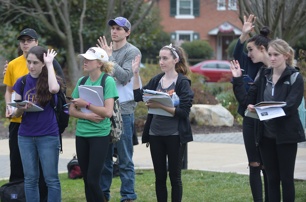 . PETE  BANNAN-DIGITAL FIRST MEDIA        West Chester University students raise their hands when asked how many will graduate with student debt.