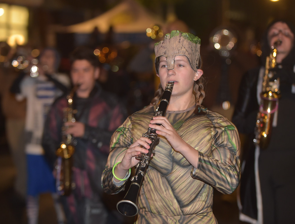. PETE BANNAN-DIGITAL FIRST MEDIA   Members of the West Chester East band all wore costumes, including clarinet player Samantha Topka who sported the look of Groot, from Marvel comics.