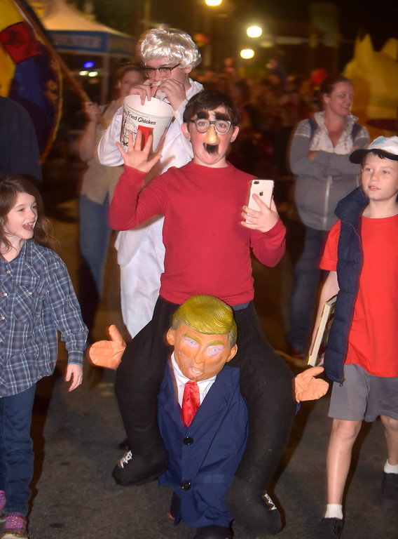 . PETE BANNAN-DIGITAL FIRST MEDIA   	Colin Gravley of West Chester Cub Scout Troop 105 was seen tweeting on the shoulders of President Trump.during the annual West Chester Halloween parade Wednesday evening.