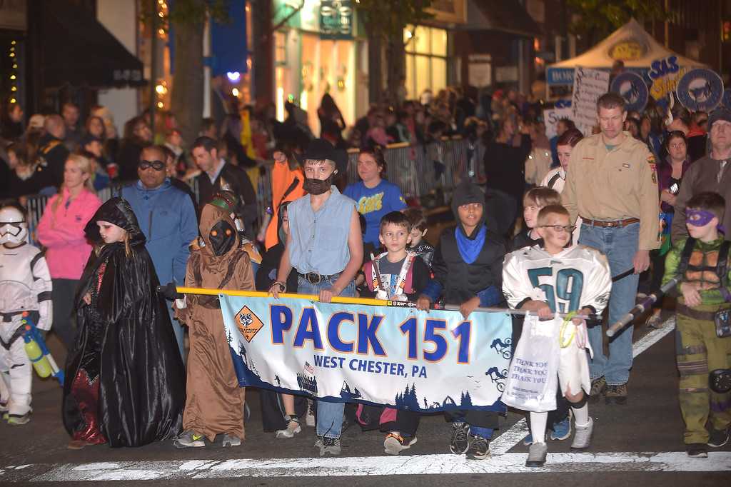 . PETE BANNAN-DIGITAL FIRST MEDIA   	CUb Scouts from Pack 151 take part in the annual West Chester Halloween parade Wednesday evening.