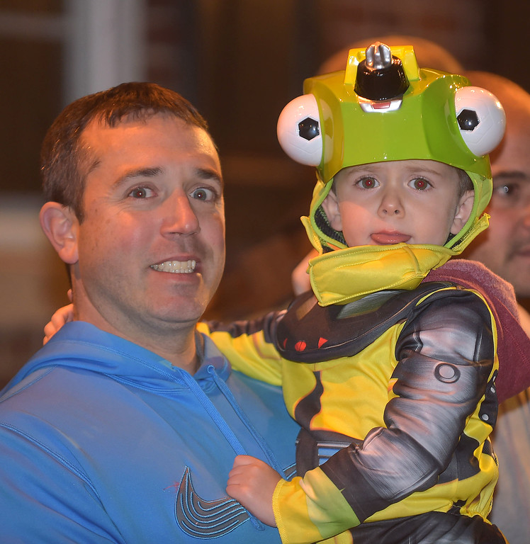 ". PETE BANNAN-DIGITAL FIRST MEDIA   	Dan Johnston and his son , Nicholas,3, dressed as ""Revvit\'  enjoy the annual West Chester Halloween parade Wednesday evening."