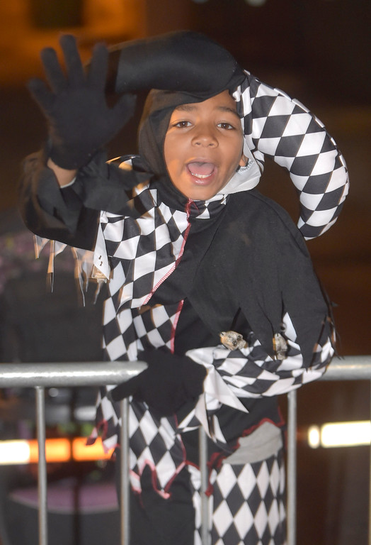. PETE BANNAN-DIGITAL FIRST MEDIA   	Jester, J.J. Dorsey Hubbard,8, of West Chester enjoys the annual West Chester Halloween parade Wednesday evening.