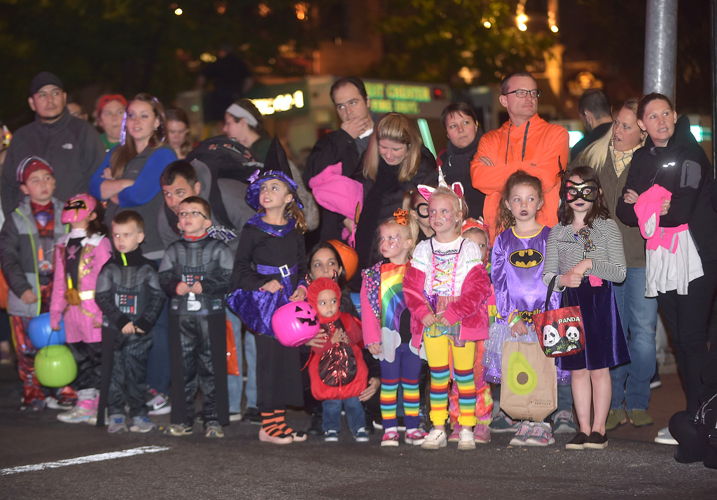 . PETE BANNAN-DIGITAL FIRST MEDIA   	Children wait for the start of the annual West Chester Halloween parade Wednesday evening.