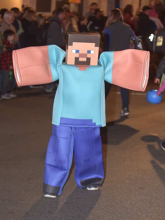 . PETE BANNAN-DIGITAL FIRST MEDIA   	Christin Barbezat,9, is a Mindcraft man during the annual West Chester Halloween parade Wednesday evening.