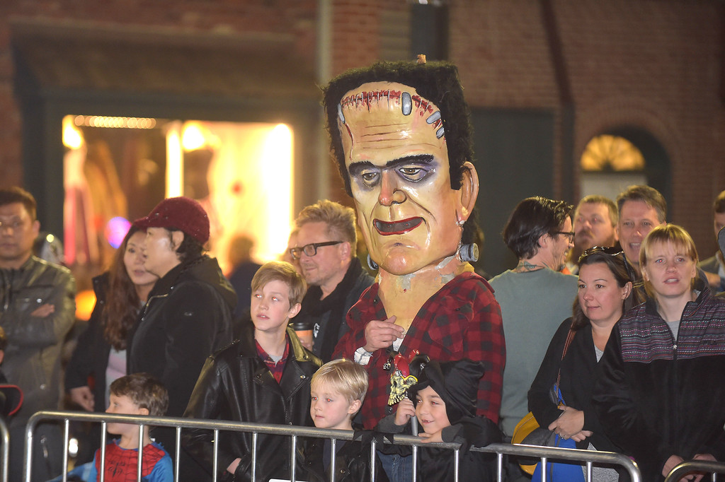 . PETE BANNAN-DIGITAL FIRST MEDIA   	Spectators included Frankenstein at the annual West Chester Halloween parade Wednesday evening.
