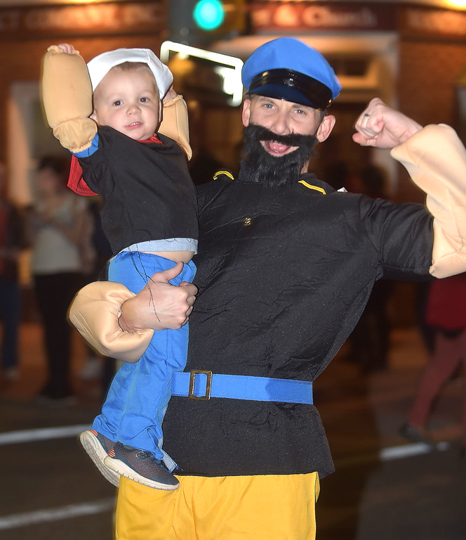 . PETE BANNAN-DIGITAL FIRST MEDIA   �We�re loving it,� said Chris Kienel of Westtown, who was at the parade with his wife, Jen and children Avery,8 months and two year-old,Gavin. They were dressed as Blutto, Popeye, Olive Oyl and Swee� Pea.