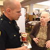PETE BANNAN-DIGITAL FIRST MEDIA  Chester County Sheriff Corporal Brad DeSando talks with West Chester resident  Virginia Schawacker at the West Chester Area Senior Center Vets and Seniors Expo Wednesday April 20, 2016.