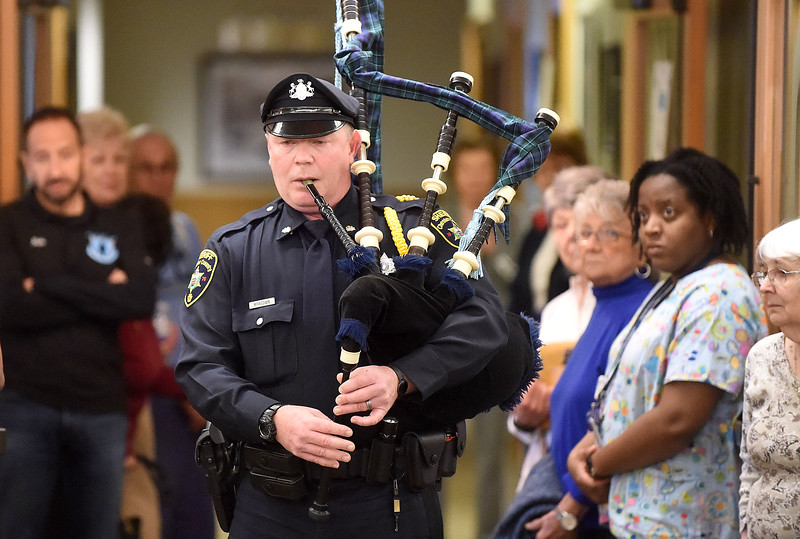 PETE BANNAN-DIGITAL FIRST MEDIA  Chester County Sheriff  officer Danny McKeown plays bagpipes at services at the West Chester Area Senior Center Vets and Seniors Expo Wednesday April 20, 2016.