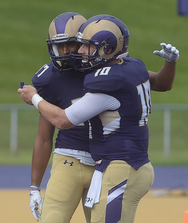 . PETE BANNAN  DIGITAL FIRST MEDIA     West Chester University receiver Jordan Banks, and quarteback Paul Dooley embrace after their 37 yard touchdown pass in the Golden Rams 51-9 victory over Bentley Thursday evening at Farrell stadium.