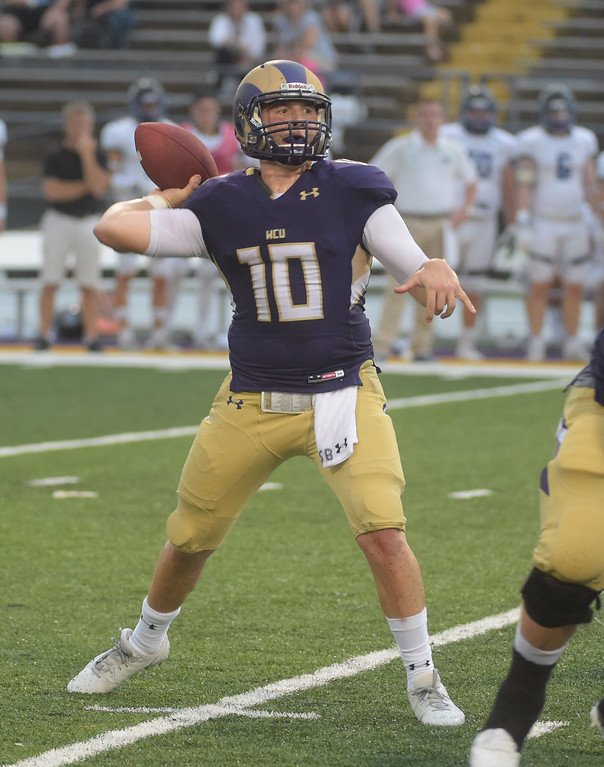 . PETE BANNAN  DIGITAL FIRST MEDIA     West Chester University quarteback Paul Dooley throws in the first of the Golden Rams 51-9 victory over Bentley Thursday evening at Farrell stadium.