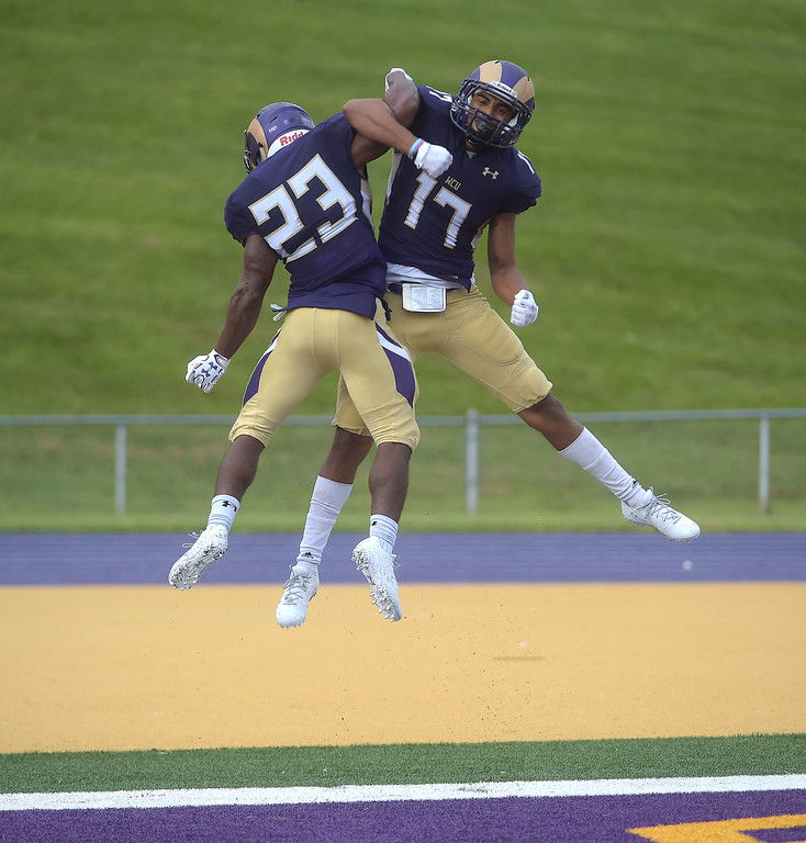 . PETE BANNAN  DIGITAL FIRST MEDIA     West Chester University receiver Jordan Banks, (17) celebrates his 37 yard touchdown pass from Paul Dooley with running back (23) Jarel Elder who had a touchdown run of his own in the Golden Rams 51-9 victory over Bentley Thursday evening at Farrell stadium.