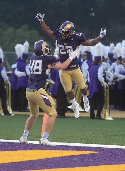 PETE BANNAN  DIGITAL FIRST MEDIA    <br /> West Chester University running back (23) Jarel Elder jumps into the arms  tight end Simon Williams after scoing laste in the second quarter of  the Golden Rams 51-9 victory over Bentley Thursday evening at Farrell stadium.
