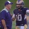 PETE BANNAN  DIGITAL FIRST MEDIA    <br /> West Chester University  head coach Bill Zwaan talks with quarterback Paul Dooley in the first half of the Golden Rams 51-9 victory over Bentley Thursday evening at Farrell stadium.