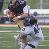 PETE BANNAN  DIGITAL FIRST MEDIA    <br /> West Chester University quarterback Paul Dooley runs into Bentley linebacker Rogers Boylan, dislodging his helmet. The Golden Rams went on to a 51-9 victory over Bentley Thursday evening at Farrell stadium.