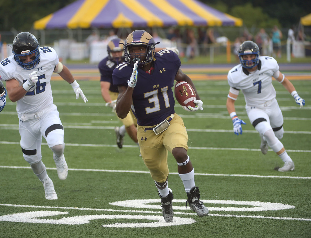 . PETE BANNAN  DIGITAL FIRST MEDIA     West Chester University running back Mark Dukes crosses the 50 yard line enroute to a 57 yard touchdown run to open the score for the Golden Rams in their 51-9 victory over Bentley Thursday evening at Farrell stadium.