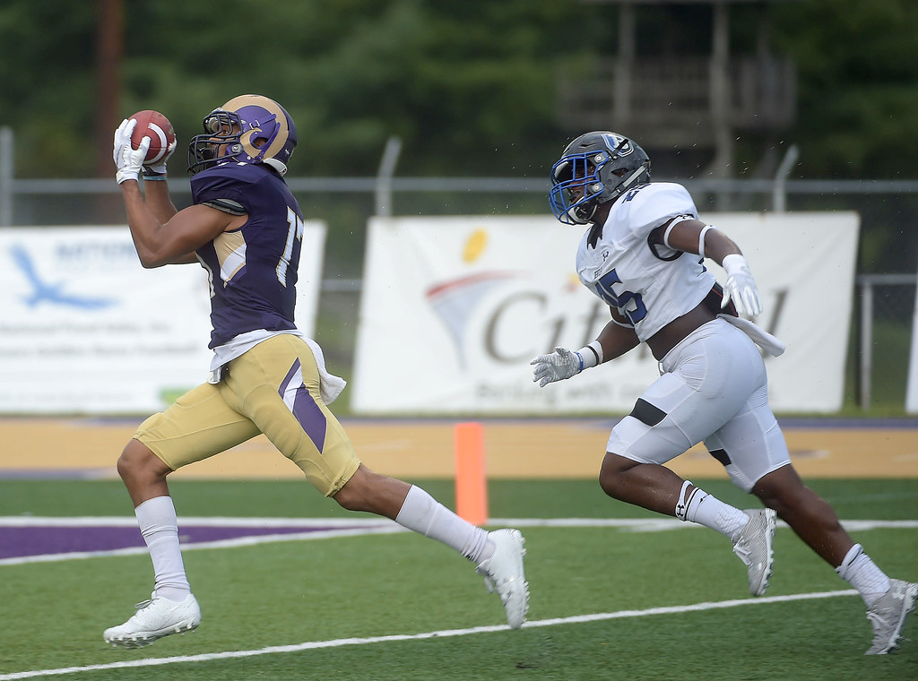 . PETE BANNAN  DIGITAL FIRST MEDIA     West Chester University receiver Jordan Banks hauls in a pass from Paul Dooley for a Golden Rams touchdown in their 51-9 victory over Bentley Thursday evening at Farrell stadium.