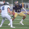 PETE BANNAN  DIGITAL FIRST MEDIA    <br /> West Chester University quarterback AJ Long tries to avoid Bentley linebacker Andrew Carmichaelin the first half for the Golden Rams in their 51-9 victory over Bentley Thursday evening at Farrell stadium.