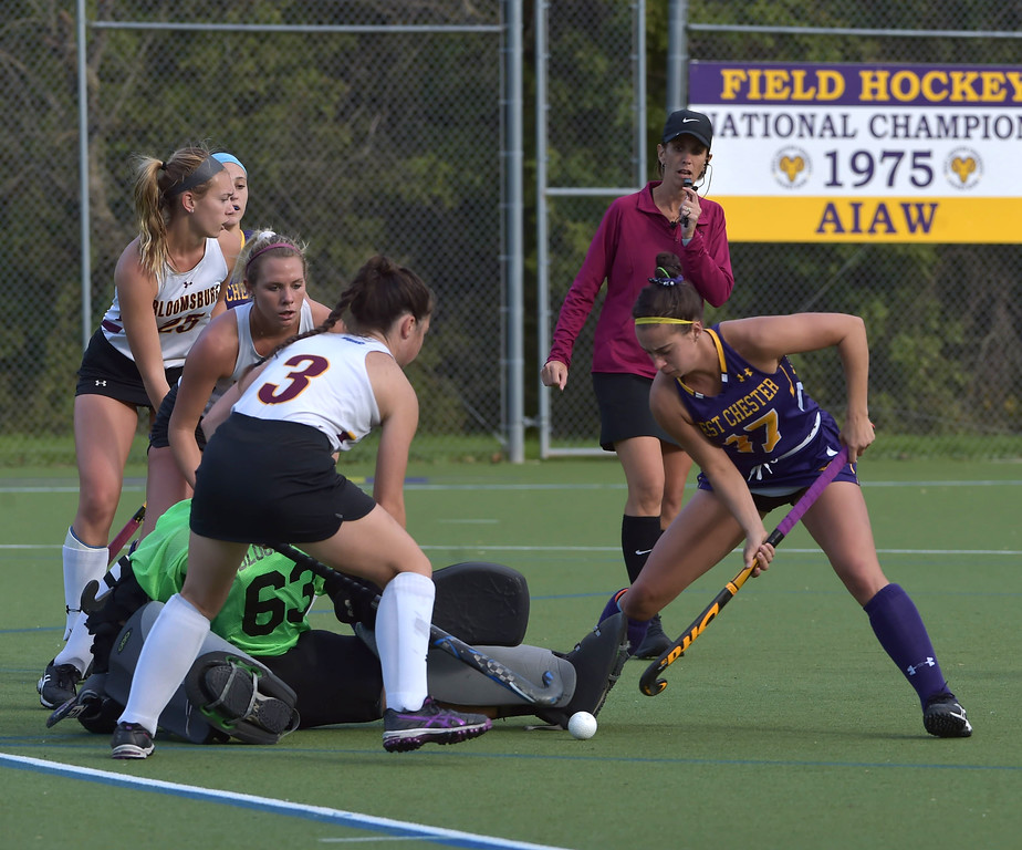 . West Chester\'s Katie Hatch digs but can\'t get the ball past Bloomsburg goalie Dana Sheply in the first half. THe second period was a different story as Hatch scored one of 4 Golden Ram goals in the 4-0 victory.