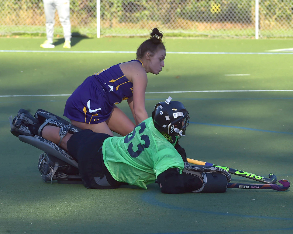 . West Chester University forward (9) Kelly Munster collides with Bloomsburg goalie Dana Sheply after scoring a second half goal Wednesday afternoon at Vonnie Gros field. The Golden Rams defeated Bloomsburg 4-0 to remain in first place in the PSAC.