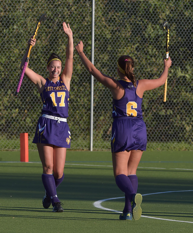 . West Chester University senior Kate Hatch (17) celebrates her second half goal with teammate Sophie Ruppert Wednesday afternoon at Vonnie Gros field. The Golden Rams defeated Bloomsburg 4-0 to remain in first place in the PSAC.