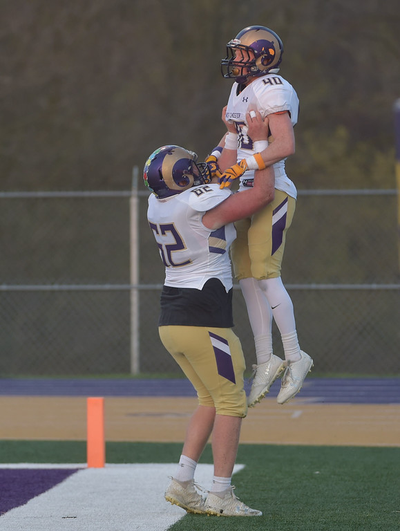 . PETE  BANNAN-DIGITAL FIRST MEDIA        West Chester Gold lineman Brendan Ruskowski lifts receiver Joe Kennedy after Kenndy caught a touchdown pass in the first half of the Purple/Gold scrimmage Friday evening April 27, 2018.