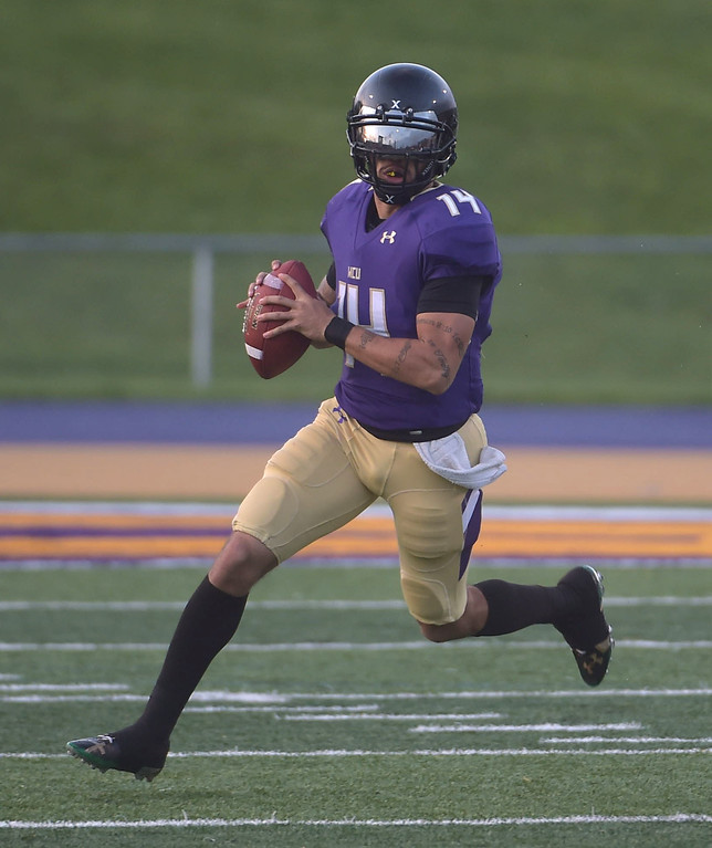 . PETE  BANNAN-DIGITAL FIRST MEDIA        West Chester quarterback  A.J. Long scrambles in the first half of the Purple/Gold scrimmage Friday evening April 27, 2018.
