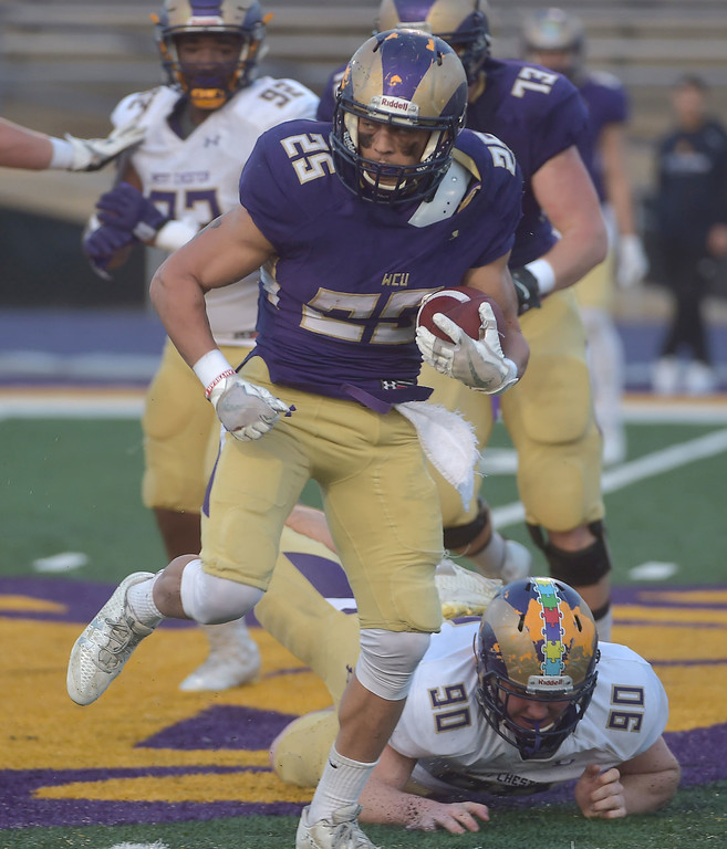. PETE  BANNAN-DIGITAL FIRST MEDIA        West Chester runningback Mike Class runs in the first half of the Purple/Gold scrimmage Friday evening April 27, 2018.