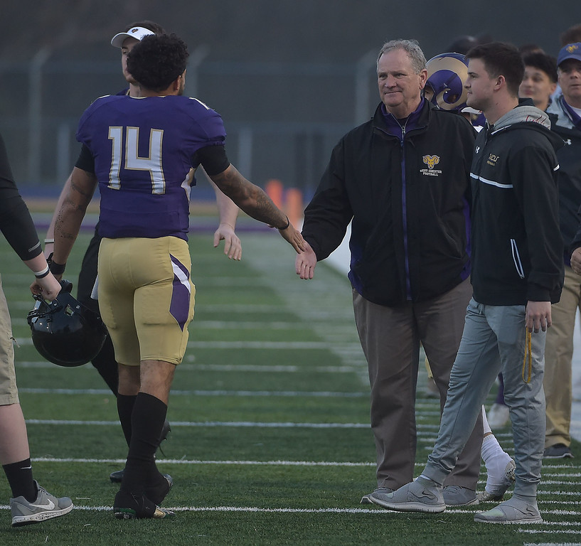 . PETE  BANNAN-DIGITAL FIRST MEDIA        West Chester coach Bill Zwaan congratulates quarterback  A.J.Long after he completed  a touchdown for Purple in the first quarter of the Purple/Gold scrimmage Friday evening April 27, 2018.