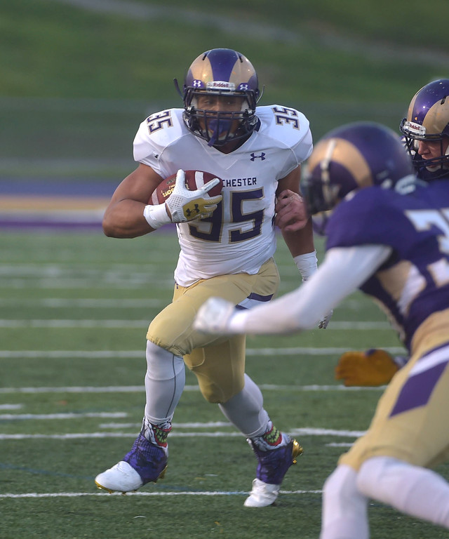. PETE  BANNAN-DIGITAL FIRST MEDIA        West Chester fullback Marcus Wilson runs in the first half of the Purple/Gold scrimmage Friday evening April 27, 2018.