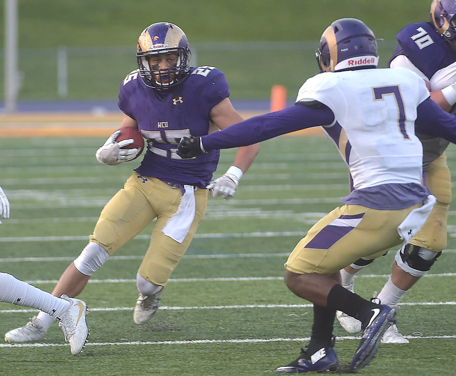 . PETE  BANNAN-DIGITAL FIRST MEDIA        West Chester runningback Mike Class tries to avoid  tackle Jarey Elder in the first half of the Purple/Gold scrimmage Friday evening April 27, 2018.