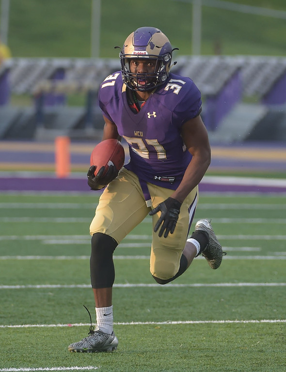 . PETE  BANNAN-DIGITAL FIRST MEDIA        West Chester runningback Mark Dukes runs in the first quarter of the Purple/Gold scrimmage Friday evening April 27, 2018.