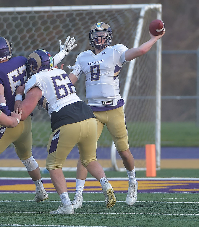 . PETE  BANNAN-DIGITAL FIRST MEDIA        West Chester quarterback Zack Gilbert throws a pass in the first half of the Purple/Gold scrimmage Friday evening April 27, 2018.