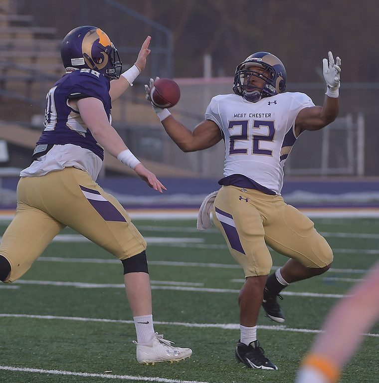. PETE  BANNAN-DIGITAL FIRST MEDIA        West Chester runningback James Bell hauls in a pass in the first half of the Purple/Gold scrimmage Friday evening April 27, 2018.