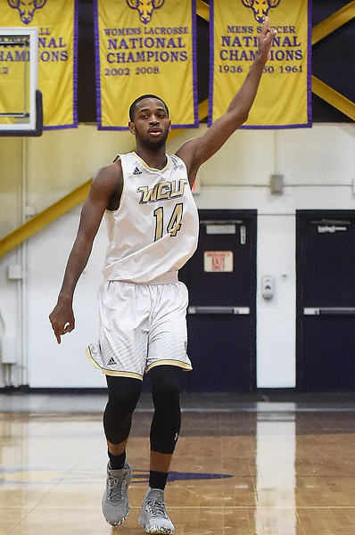 PETE  BANNAN-DIGITAL FIRST MEDIA     West Chester University's #14 signals after hiting a three pointer in the second half against California University Friday evening at Hollinger Field House. The Rams won 72-70. Long had a game high 19 points.