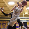 PETE  BANNAN-DIGITAL FIRST MEDIA     West Chester University's #10 Jackson Hyland shoots against California University Friday evening at Hollinger Field House. The Rams won 72-70. Hyland is a graduate of Kennett High School.