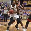 PETE  BANNAN-DIGITAL FIRST MEDIA     West Chester University's #14 Tyrell Long in the second half against California University Friday evening at Hollinger Field House. The Rams won 72-70. Long had a game high 19 points.