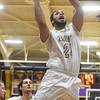 PETE  BANNAN-DIGITAL FIRST MEDIA     West Chester University's #24 Thomas White takes a shot in the first half against California University Friday evening at Hollinger Field House. The Rams won 72-70.