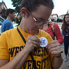 """PETE BANNAN-DIGITAL FIRST MEDIA  West Chester University sophomore Lauren Platt pins a strike button on in support of the faculty which went on strike Wednesday Oct.19, 2016. """"It makes me sick to hear the state walked of negotiations"""", Platt said."""