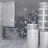 An overheated industrial oven at the Whitford Chemical Co., 20 N. Matlock st., West Chester, brought West Chester's three fire companies to the building on a general alarm at 7:59 p.m. last night.(May 19,1966) <br /> Firemen, using smoke masks, are shown using hand extinguishers to quell the fire in the oven.<br /> The fire caused little damage except to the oven itself, but spread acrid fumes in the area around the company.<br /> Officials say there was no danger of explosion from the materials in use at he plant.
