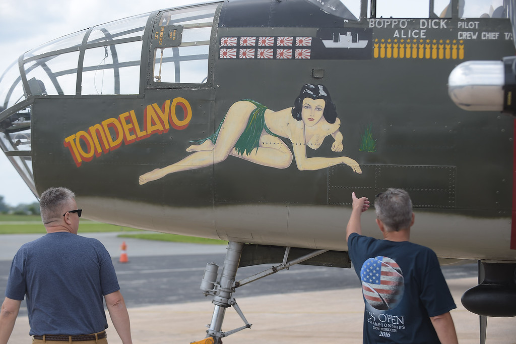 . PETE BANNAN  DIGITAL FIRST MEDIA    Jeff and Mike Morris of Wallingford  look at the artwork on the Consolidated B-24 Liberator �Witchcraft� WWII Heavy Bomber.