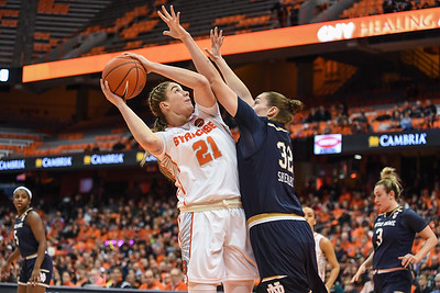Emily Engstler trys to gets points for Syracuse